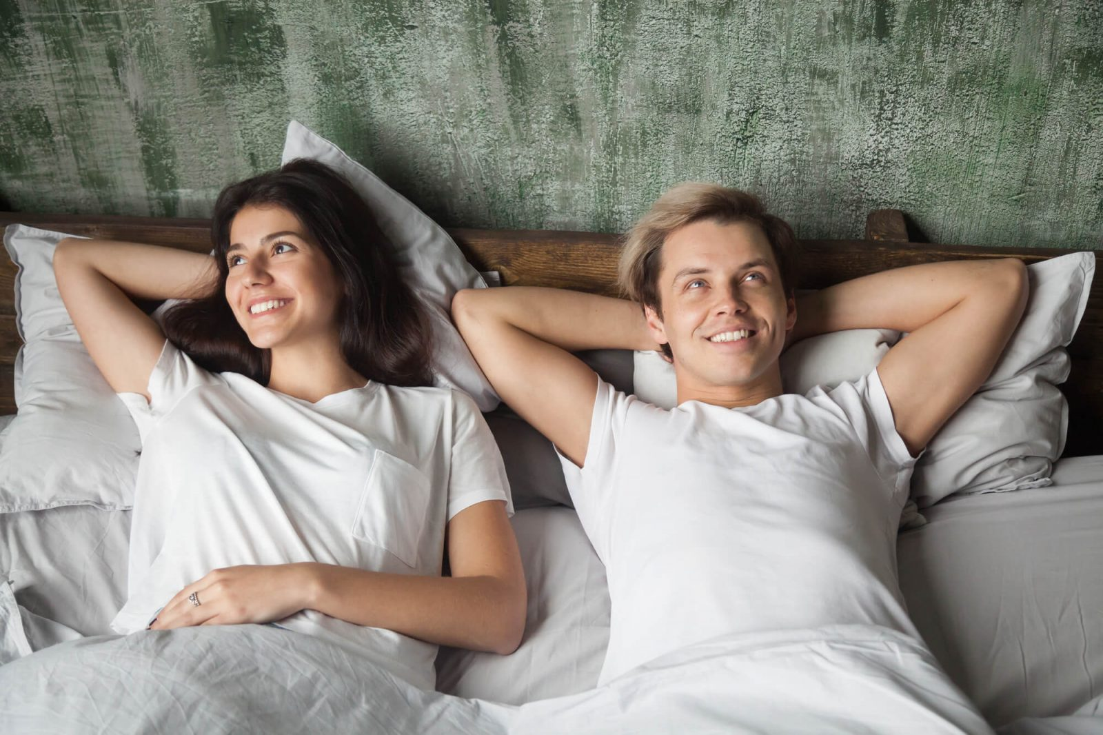 happy couples sleeping on mattress